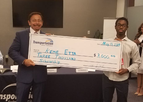 Ekpeme receives a check for $3000 from TFCU